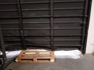 Commercial Overhead Door - Houston - Accident with pallet - Warehouse